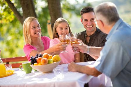 Portrait of lovely family having picnic in nature