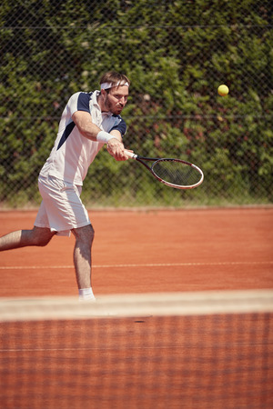 professionally: Professionally tennis player serving ball