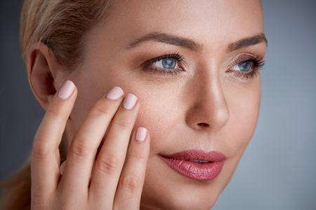 Close up of woman with skin  and looking wrinkles;