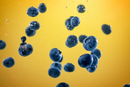 blueberry splashing in tank of water background Stock Photo