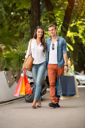 sidewalk sale: shopping couple outdoor with shopping bags