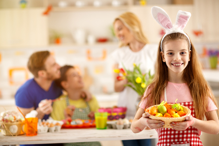 Girl show basket with painting Easter eggs Stock Photo - 74650558