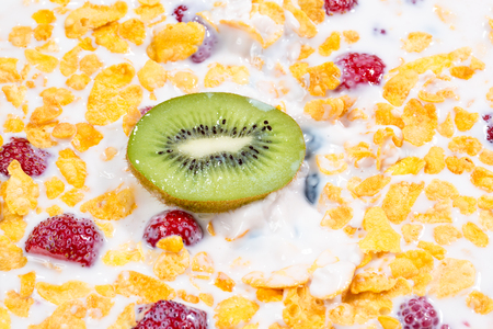 muesli and fresh berries and fruits kiwi close up