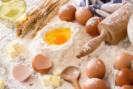 Baking cookies with ingredients- eggs, flour, milk