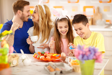 Family together in kitchen prepare Easter celebration