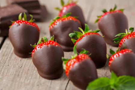 Fresh red strawberry glazed with chocolate