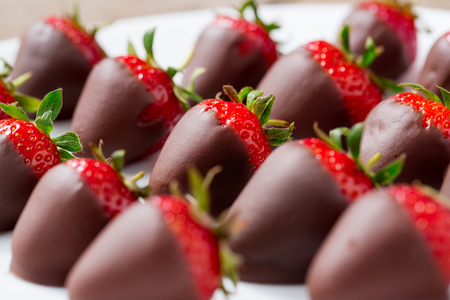 strawberries dipped in dark chocolate close up