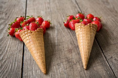 Strawberries shaped and ice cream cones background Stock Photo