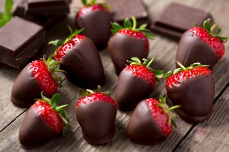 dark chocolate and red strawberries Stock Photo