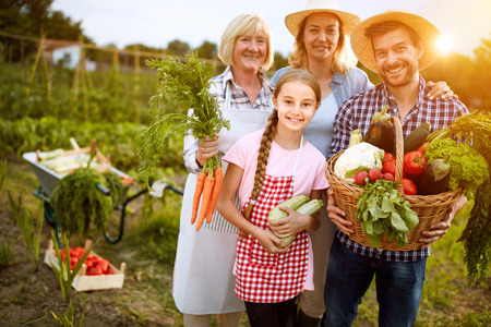Rural family satisfied with their organic vegetables from garden Stock Photo