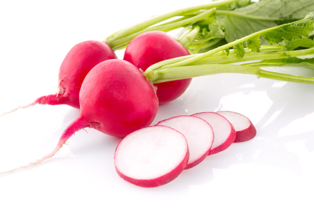 close up radish with cutting out slice isolated on white background Stock Photo