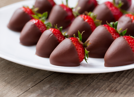 Homemade red strawberries dipped in chocolate