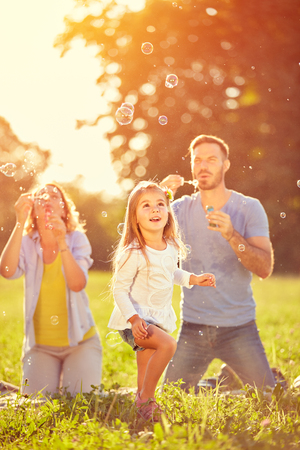 Entertainment in nature for child with shinny soap bubbles