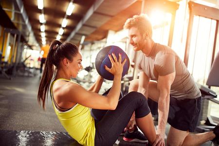 female fitness: Female exercise abs in fitness center