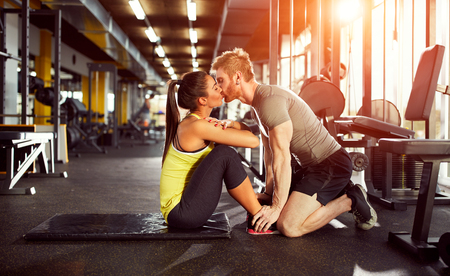 Kiss from fitness partner as prize for well done exercise Stock Photo - 76684753