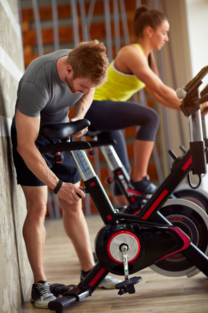 Male adapt exercise bike in gym photo