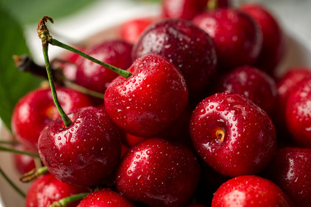 Red, ripe, juicy cherries, water drops, close up background Stock Photo