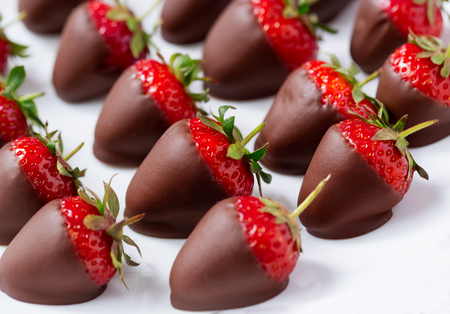 Strawberries in dark chocolate close up