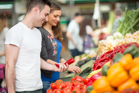 Couple shopping organic fruits at the market photo