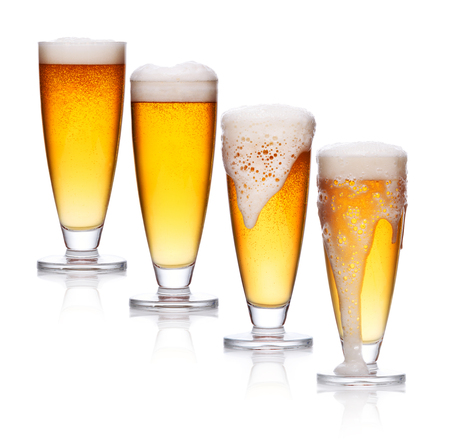 set of glass of light beer foam. lager beer in a glass beaker with fresh bubbling foam isolate on white Stok Fotoğraf