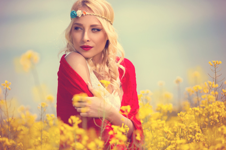 Pretty girl in yellow flowers, outdoor portrait