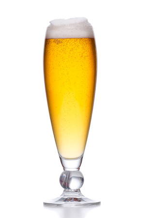 Beer glass filled with light beer. Full glass with foam on white background