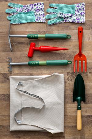 top view garden tools on wooden texture background