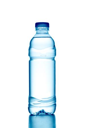 Fresh water splashing out of bottle, isolated on white background Stock Photo