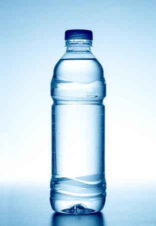 Bottle of fresh water on white background