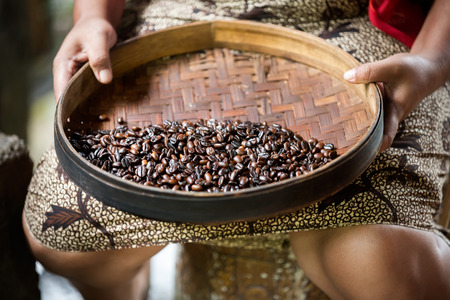 manual production of Kopi luwak coffee, process of removing impurities Stock Photo