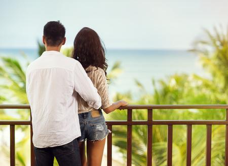 Romantic happy couple on balcony, back view  Imagens