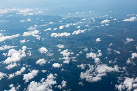 ジェット飛行機からの雲と青空が広がって 写真素材
