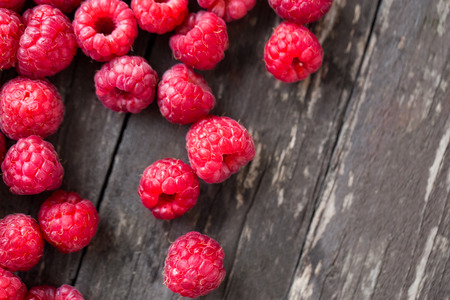 Summer fresh fruits. Raspberry on wooden table background