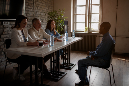 Startup team having a job interview with candidate in the office