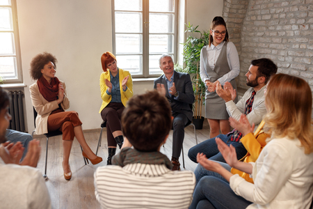 Creative business people meeting in circle of chairs Stock Photo