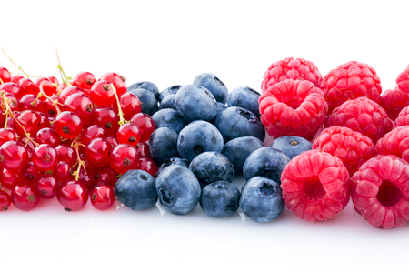 raspberry, blueberry, currant, different berries isolated on white
