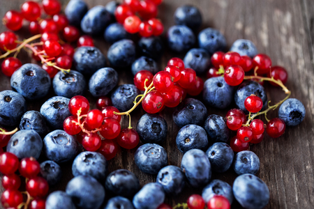 Freshly picked blueberries and currant background Stock Photo