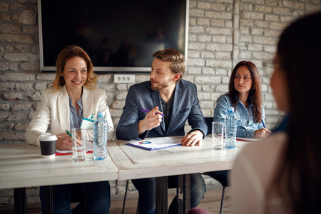 business people consulting about a potential candidate for the job position Stock Photo