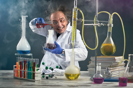 Crazy chemist doing experiment chemical laboratory Reklamní fotografie - 85077973