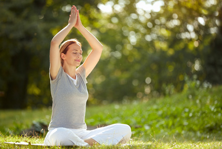 Woman meditates and relax in yoga pose in forest