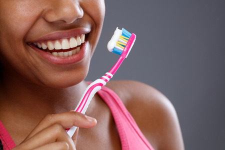 Woman with healthy and clean teeth during brushing