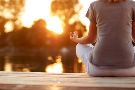 Woman in yoga position meditates- body part Stock fotó - 85000667