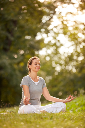 Female meditates in yoga pose in forest Stock fotó - 85046319