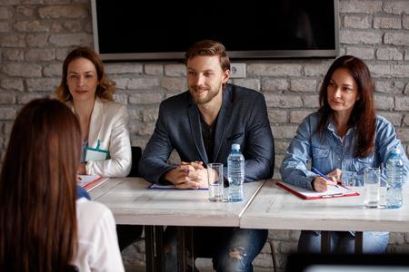 Members of company commission interviewing candidate Фото со стока