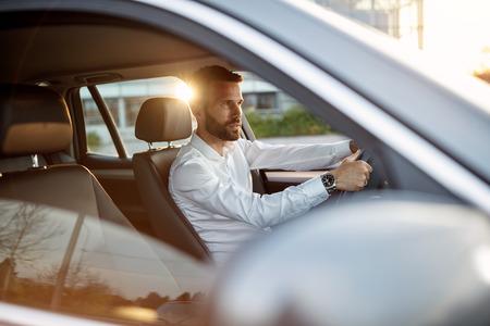success elegant businessman driving car