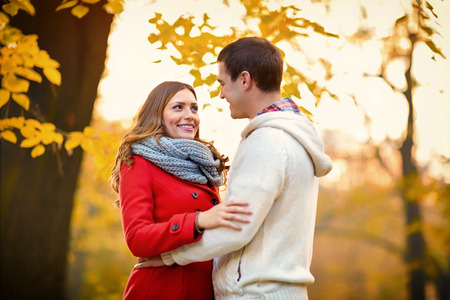 Beautiful couple in love at autumn in park