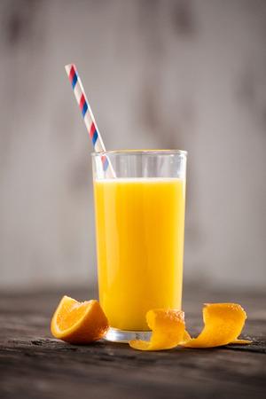 orange juice with orange slices on wooden table