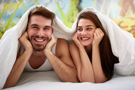 Male and female in the morning in bed having fun