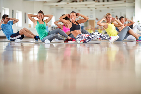 Group of young people on training at gym Stock fotó - 86178206