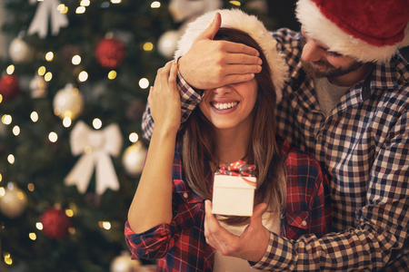 Young couple have Christmas surprise for holiday